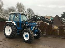 Traktor Ford 67I0/ Quicke 434O (1616413743/4)